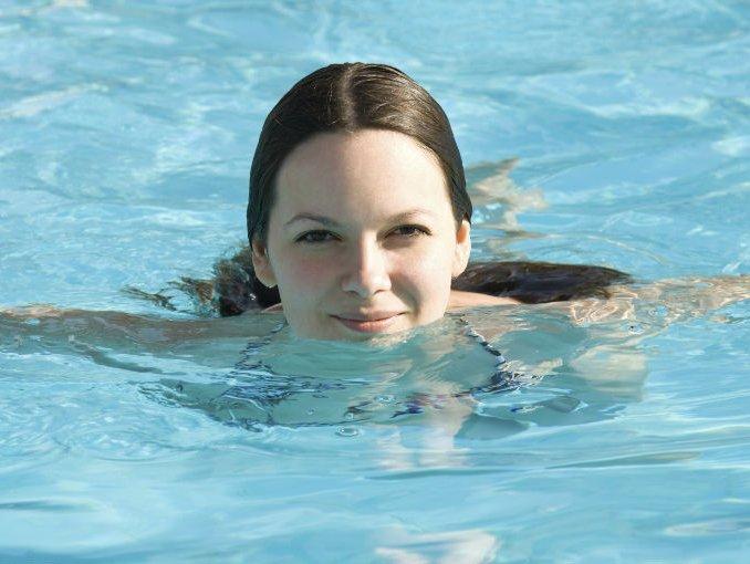 Woman swimming pool